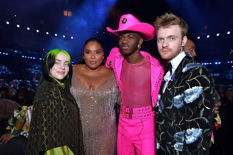 Four of the most-nominated artists at the 62nd annual Grammy Awards -- (from left to right) Billie Eilish, Lizzo, Lil Nas X, and Finneas O'Connell -- pose in the audience during the broadcast.