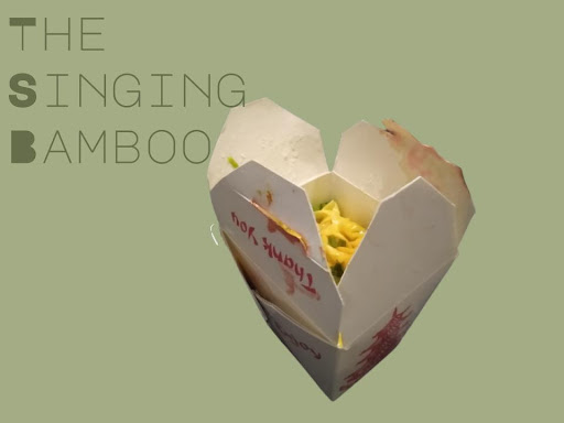 Food Container Pictured Next to Text The Singing Bamboo