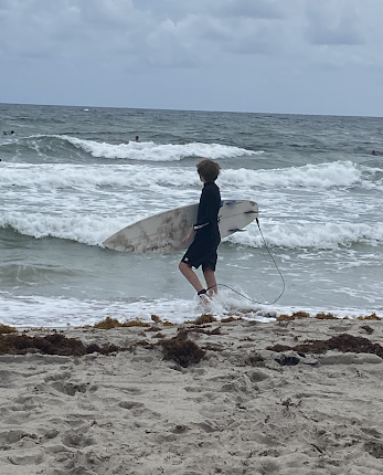 Connor Shields with Surfboard